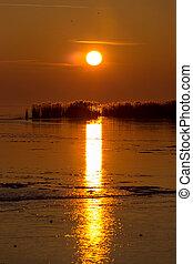 Beautiful sunset on a frozen lake