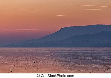 Beautiful sunset on a frozen lake Balaton of Hungary