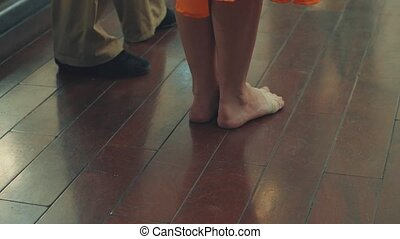 The legs of dancing people in the dance hall