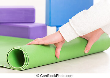 Rolling up a yoga mat