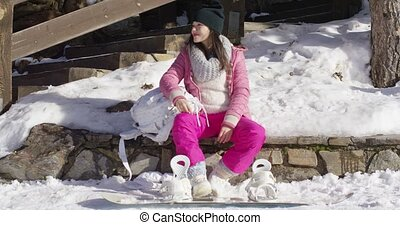 Young woman on skiing holiday - Pretty young asian woman in...