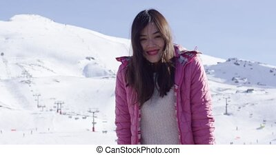 Carefree young woman in snowy ski resort