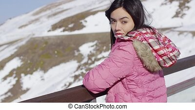 Beautiful woman in snowy mountains - Portrait of beautiful...