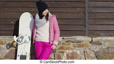 Pretty young woman with snowboard - Three quarter body...