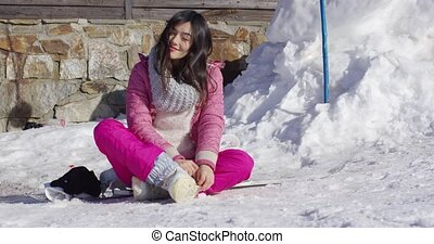 Young woman relaxing on skiing holiday - Full body portrait...