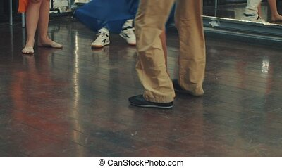 The legs of people dancing in the dance hall. Dancing steps...