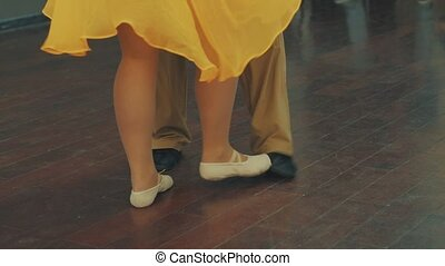 The legs of people dancing in the dance hall. Dancing steps