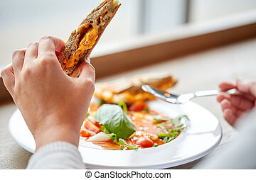 close up of woman eating soup with sandwich - food, dinner,...