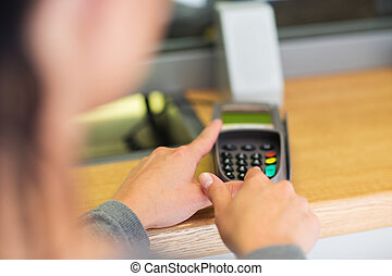 hand entering pin code to card reader terminal - finance,...