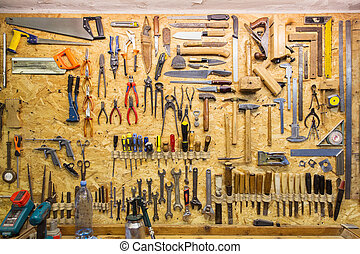 work tools hanging on wall at workshop - carpentry, woodwork...