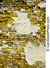 Old yellow wall with cracks and patches of plaster - Old...