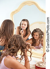 Make-up scene - Two young girls near mirror during make-up