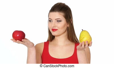 woman chooses between Apple and pear - woman chooses between...