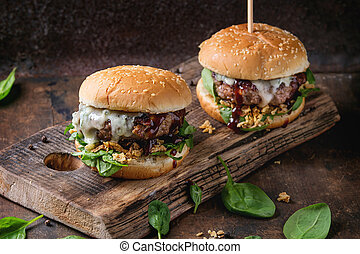 Hamburgers with beef and spinach - Two hamburgers with beef...