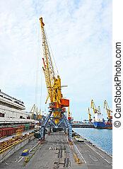 Cargo crane, pipe and train