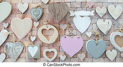Variety of hearts on stone background - Variety of wooden...