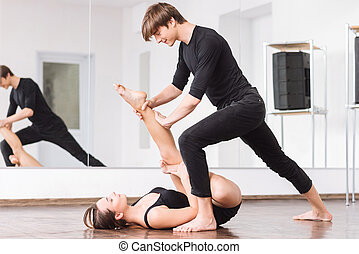 Handsome cute man bending over his dance partner - Need some...