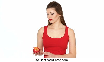 woman holding red apple and smiling on white background