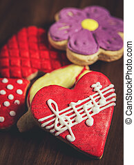 Sugar cookies with glaze, heart with musical notes