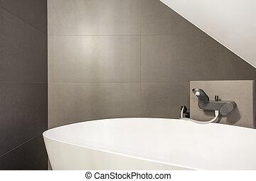 Minimalistic oval bathtub in modern bathroom