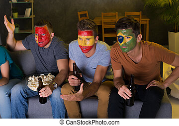 Men with colorful football faces - Men with colorful faces...