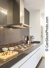 Steel kitchen design with stove