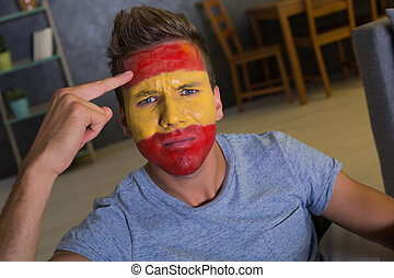 Football fan with painted flag of Spain
