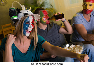 Woman and men cheering - Woman and two men with colored...