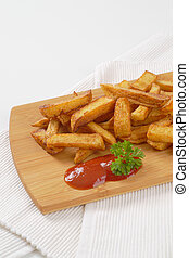 fried chipped potatoes - heap of fried chipped potatoes with...