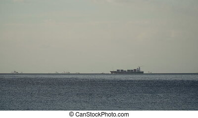 Cargo ship sails on the sea. Philippines, Manila. - Cargo...