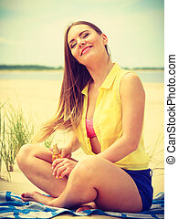 Woman with sun oil. - Skin protection in summer. Woman on...