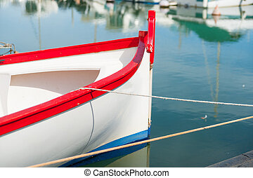 Bold red, white blue closeup of aft of...
