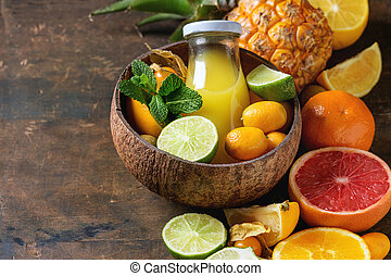 Variety of citrus fruits - Variety of whole and sliced...