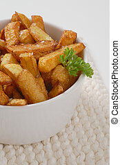 fried chipped potatoes - bowl of fried chipped potatoes