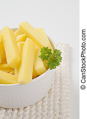 raw chipped potatoes - bowl of raw chipped potatoes