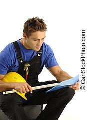 giovane, lavoratore, lettura, istruzioni