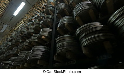 Film Archive. Films, movie reels on a shelfs in a huge old...