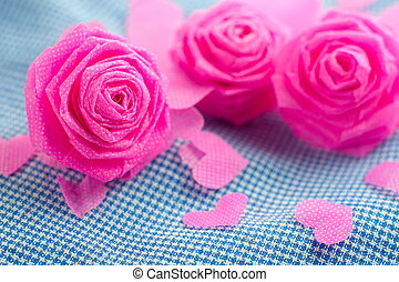 Pink rose and small hart on blue cloth background for Valentine festival.