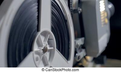 vintage film projector. - vintage film projector working in...