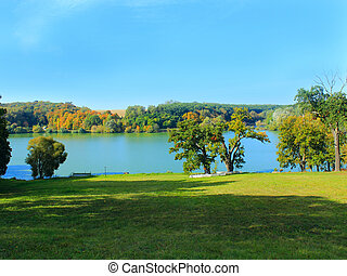 beautiful landscape with picturesque lake and trees -...