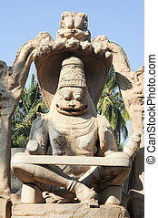 Statue of Lakshmi Narasimha at Hampi on India - Statue of...