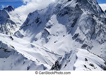 Winter mountains with snow cornice in nice sun day. Caucasus...
