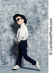 cool little guy - Cute little boy in elegant clothes and...