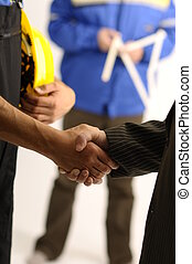 Working Agreement - Handshake and one man in background