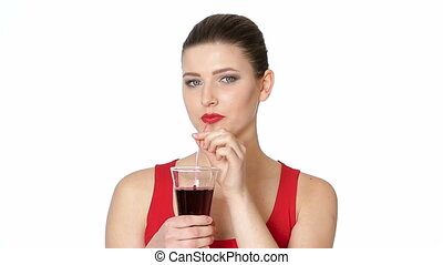 brunette woman drinking cherry juice from glass - beautiful...