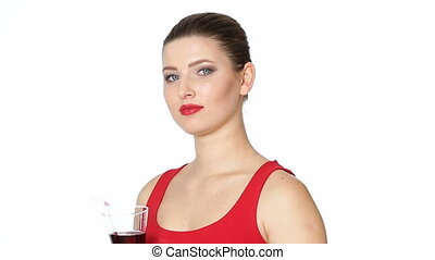 brunette woman with glass of cherry juice - beautiful...