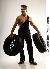 Body-building - A man with two car tires