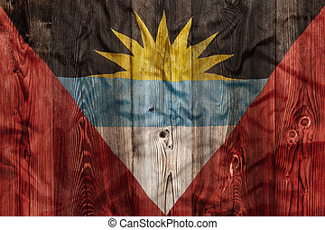 National flag of Antigua Barbuda, wooden background -...