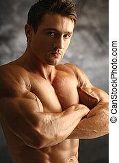 Muscleman - Young attractive muscleman poses