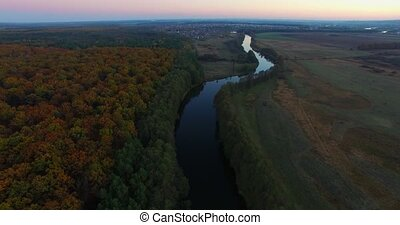 Aerial view the river on green forest plain.